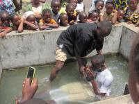Baptism in Ghana after using the Solar Player